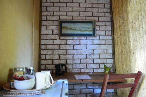 A television and/or entertainment center at Nxabii Cottages