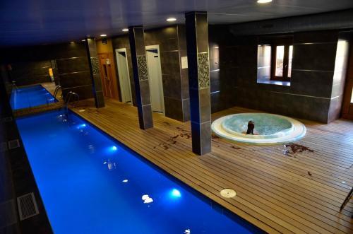The swimming pool at or near Apartamentos Spa Cantabria Infinita