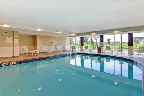 The swimming pool at or near Residences at Kanata Lakes