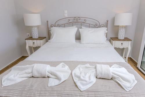 Кровать или кровати в номере Barefoot Contessa Lourdas
