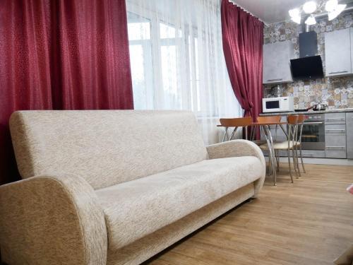 A seating area at Квартира - студия