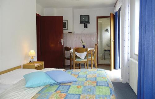 Postelja oz. postelje v sobi nastanitve Three-Bedroom Apartment in Kranjska Gora