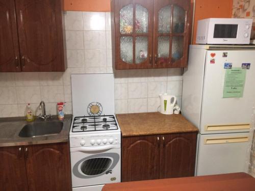 Кухня или мини-кухня в Апартаменты на Водопьянова 1