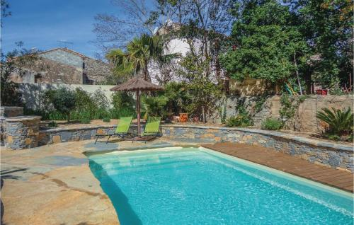 The swimming pool at or near Five-Bedroom Holiday Home in Puimisson