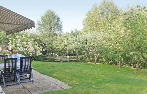 A garden outside Holiday Home Huddinge with a Fireplace 09