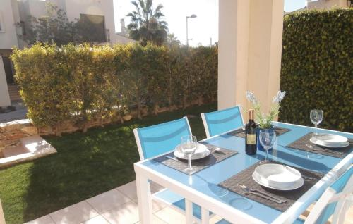 A restaurant or other place to eat at Two-Bedroom Holiday home San Javier 0 01