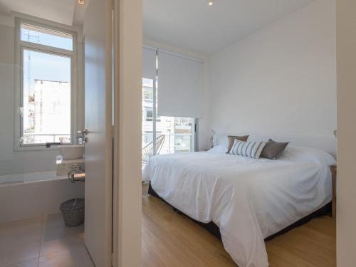 Una cama o camas en una habitación de Apartamentos Paunero y Las Heras