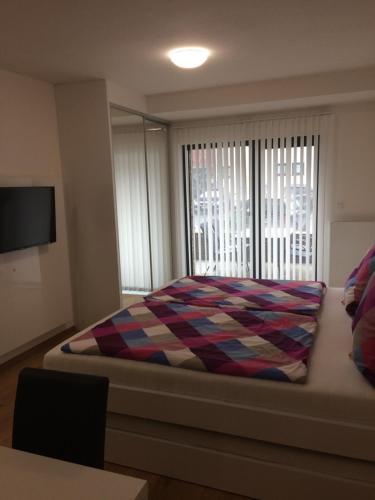 Postel nebo postele na pokoji v ubytování Apartmán Dara
