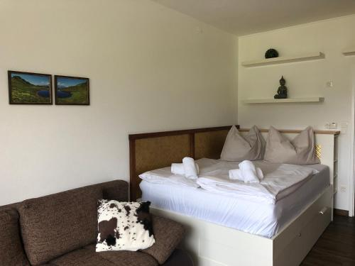 A bed or beds in a room at Alpine Studio Apartment - Dachstein Mountain View