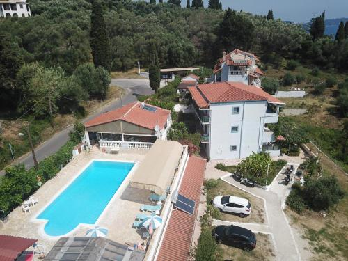 A view of the pool at Andromaches Holiday Apartments or nearby