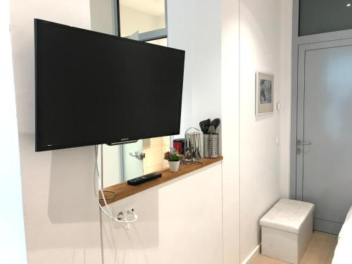 A television and/or entertainment center at small luxus apartment