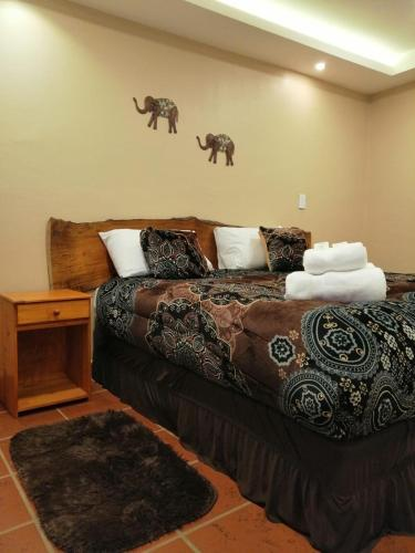 A bed or beds in a room at Ambay Suites & Dorms