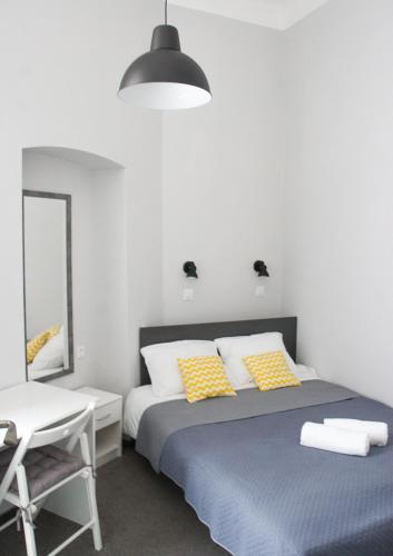Posteľ alebo postele v izbe v ubytovaní Peregrinus Rooms & Apartments