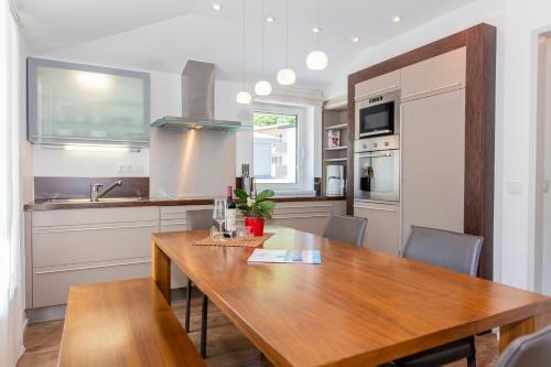 مطبخ أو مطبخ صغير في شقق غليتشربليك الفندقية