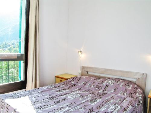 A bed or beds in a room at Apartment La Balme.4