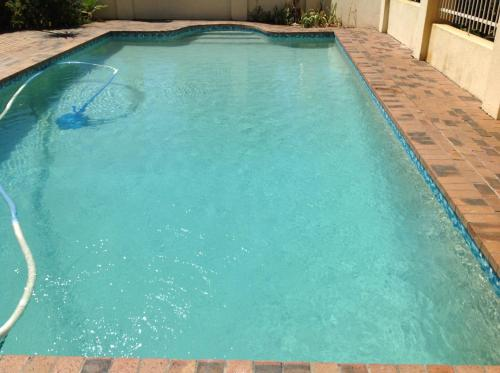 The swimming pool at or near Serengeti Self Catering Apartments