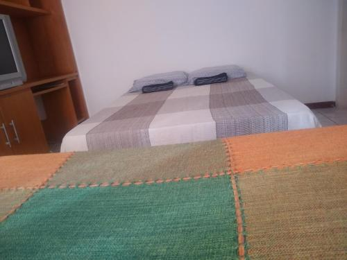 A bed or beds in a room at salvador, barra