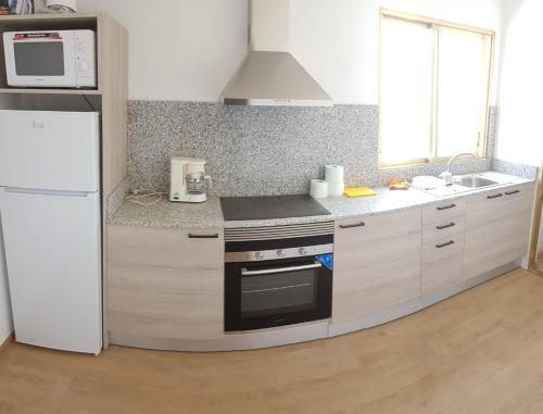 Una cocina o zona de cocina en Principado Marina