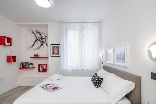 A bed or beds in a room at Cadorna 10 - Milan Home Apartments