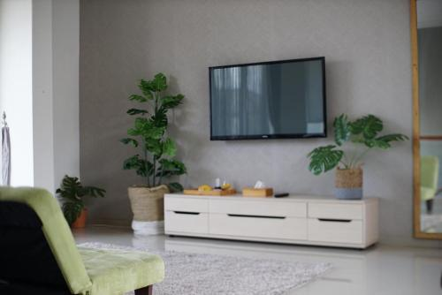 A television and/or entertainment centre at Cendana Villa
