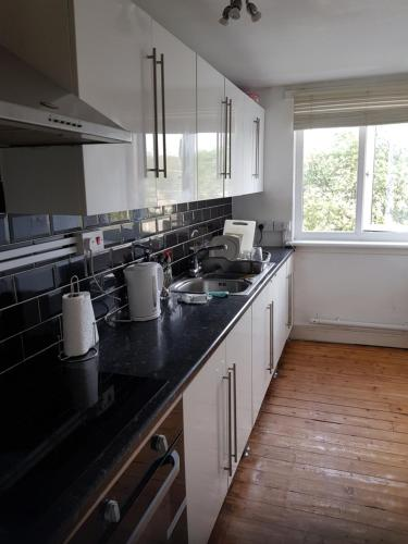 A kitchen or kitchenette at 137B Greenrigg Road Apartment