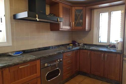 Een keuken of kitchenette bij Villa Corralejo