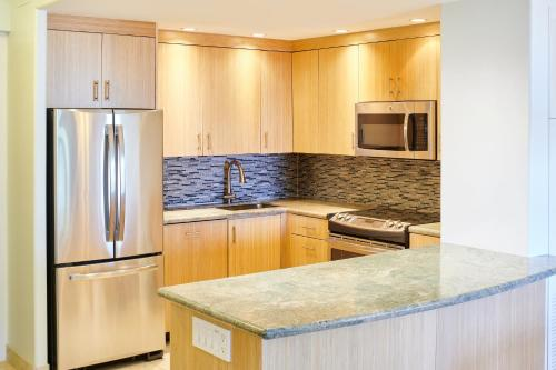 A kitchen or kitchenette at Aston at The Whaler on Kaanapali Beach