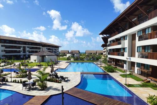 A piscina localizada em Flat Cupe Beach Living ou nos arredores