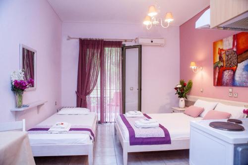 Ένα ή περισσότερα κρεβάτια σε δωμάτιο στο Nontas Home