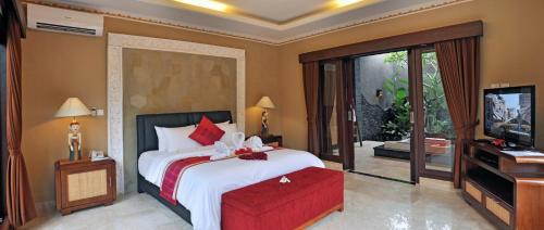 A bed or beds in a room at Bali Aroma Exclusive Villas