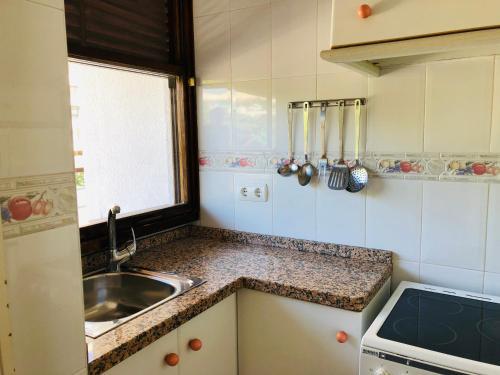 A kitchen or kitchenette at Apartamentos la Nogalera