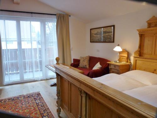 Ein Bett oder Betten in einem Zimmer der Unterkunft Ferienwohnungen Doktorwirt