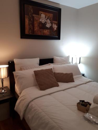 A bed or beds in a room at L.Laurentien