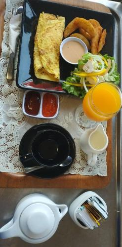 Breakfast options available to guests at Roosseno Plaza Serviced Apartment