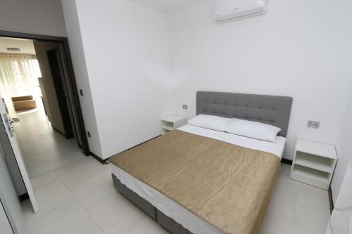 Postel nebo postele na pokoji v ubytování Kristal Paris Apartments