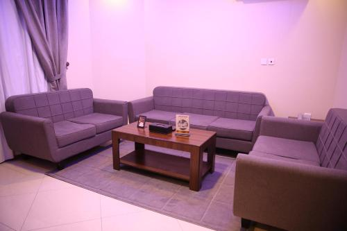 A seating area at Swat Furnished Apartment