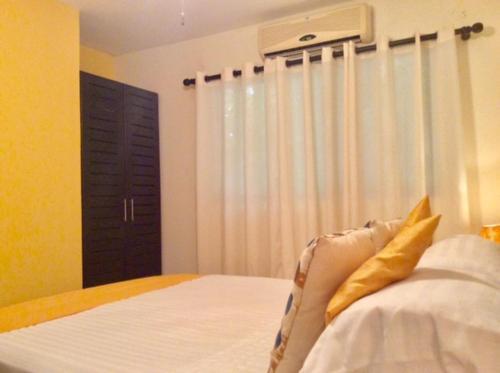 Cama o camas de una habitación en New Cocomarindo 12 Playas del Coco