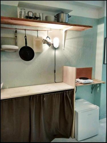 Η κουζίνα ή μικρή κουζίνα στο Cocoyam Indigo