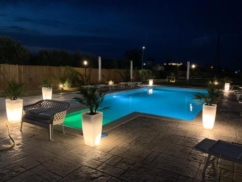 The swimming pool at or near Residenze La Villa