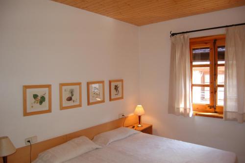 Cama o camas de una habitación en Apartaments Vall Ferrera