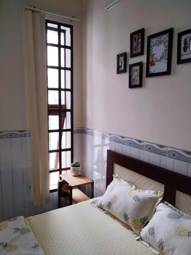 A bed or beds in a room at Duy's home - coffee shop