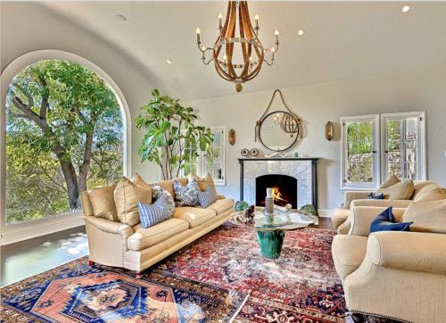 A seating area at Plush Greenery Mediterranean House with Jacuzzi