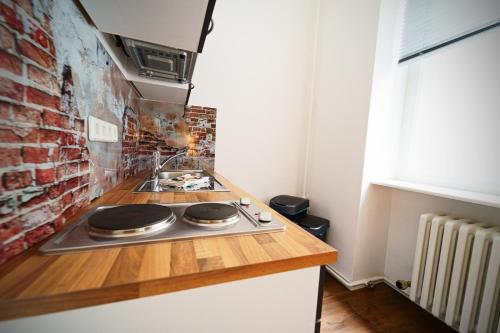 A kitchen or kitchenette at Planet Berlin City Apartments