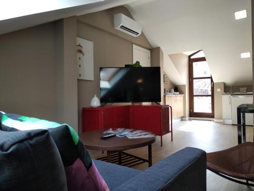 A television and/or entertainment centre at La Casa Tahona Plaza de Cervantes