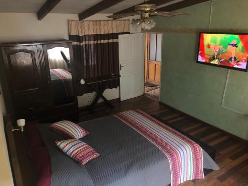 Cama o camas de una habitación en The Wasi