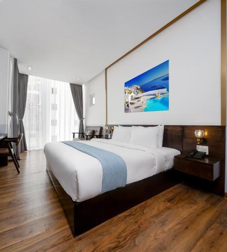 Cama o camas de una habitación en Chill Suites Danang-Beach