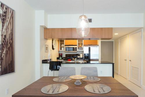 A kitchen or kitchenette at Opera Tower By Suarez Vacation Rentals