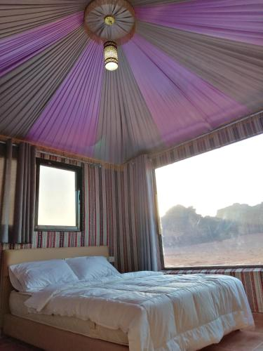 A bed or beds in a room at Wadi Rum Legend camp