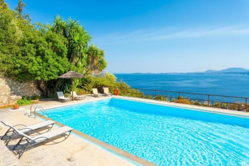 The swimming pool at or near Villa Luisa