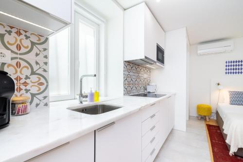 A cozinha ou cozinha compacta de Porta do Mar | Deluxe Serviced Apartments